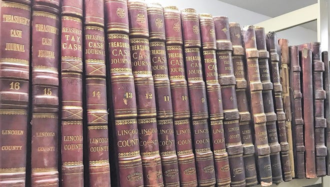 A row of historical tax books, which often note the number of horses owned by a resident.