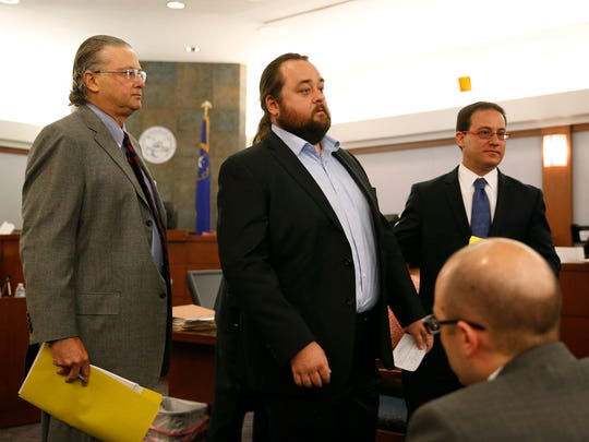 """Austin Lee Russell, center, better known as Chumlee from the TV series """"Pawn Stars,"""" appears in court with attorneys David Chesnoff, left, and Richard Schonfeld, Monday, May 23, 2016, in Las Vegas. Russell and his lawyers told a Las Vegas judge he intends to plead guilty in state court to felony weapon and misdemeanor attempted drug possession charges."""