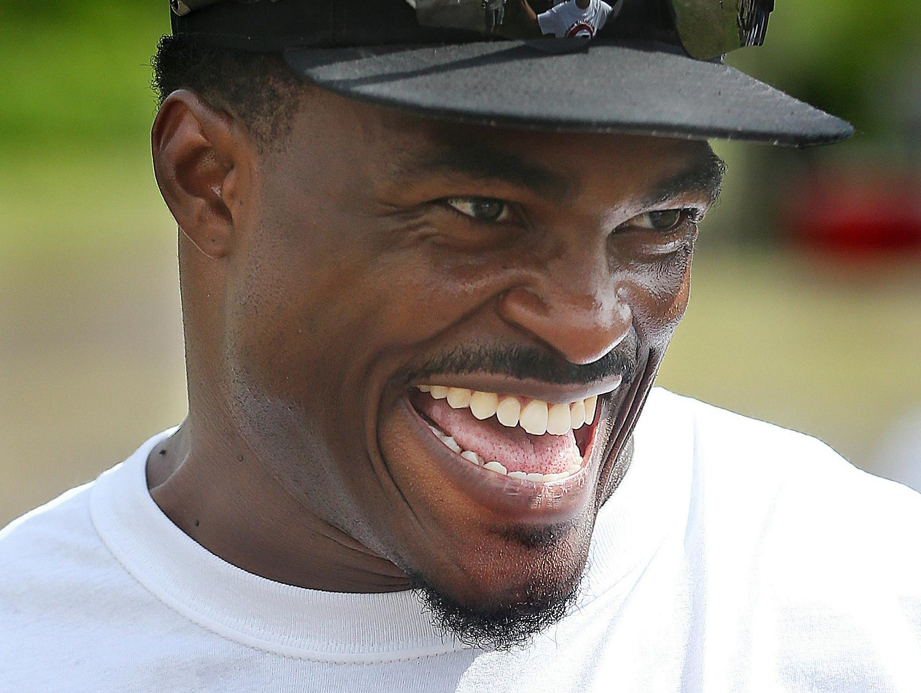 """Ernie Sims smiles as he watches young players go through their drills at last year's 7th annual Ernie Sims Celebrity Weekend, which benefits his charitable initiative, the Ernie Sims Big HITS Foundation. The Big HITS Foundation was launched in March 2009 to support community-based organizations serving at-risk youth and to promote animal humanity. HITS stands for """"Helping to Instill Tools for Success."""""""