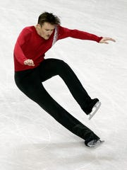 Jeremy Abbott falls during his performance in the men's