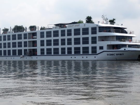 The Scenic Spirit anchored on the Mekong River near