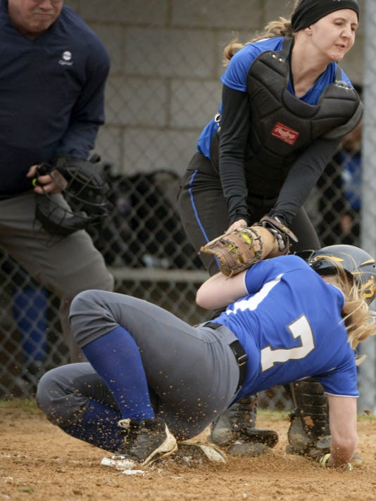 Cedar Crest's Anna Debellis is tagged out at home plate by Garden Spot's Courtney Petersheim in the first inning on Friday. Crest fell to Garden Spot, 2-0.