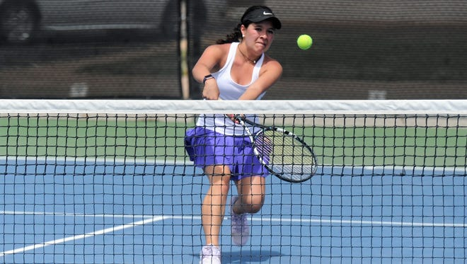 Wylie's Analeah Elias comes to the net during the girls singles championship match of the Abilene Eagle Invitational at Abilene High on Saturday, March 24, 2018.