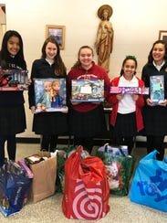 Pictured, left to right, with some of the toy donations,