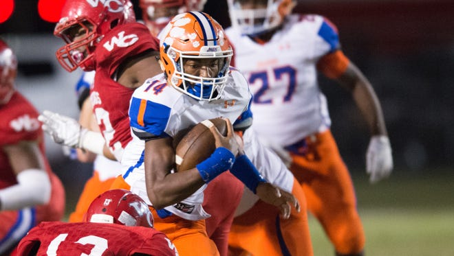Madison Central's Jimmy Holiday runs the ball during the Madison Central vs Warren Central in Vicksburg.