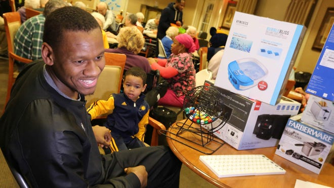 Indiana Pacers forward Lavoy Allen and his son Kai Allen host Bingo Night held at The Hearth at Tudor Gardens senior living home, Thursday January 14th, 2016.