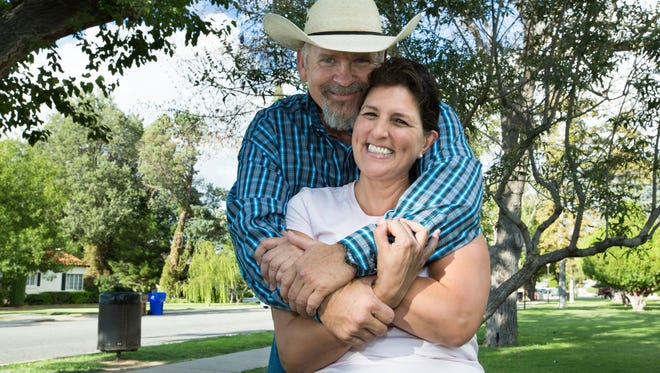 By her second cancer treatment for breast cancer, Lisa White said she didn't want to live and considered giving up. But the support of her now-husband Cody McDougal helped to give her strength. The couple is seen here at Pioneer Women's Park.