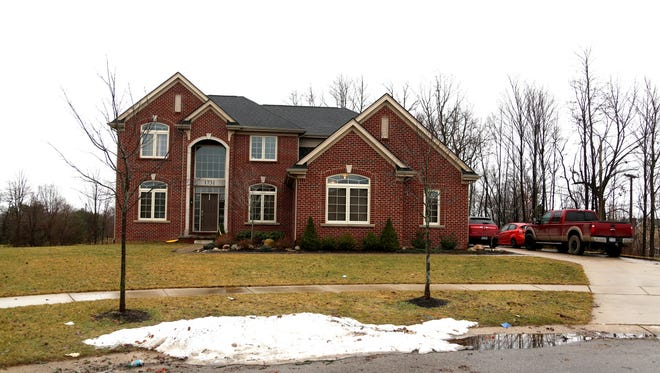 Former Quicken Loans executive Noah Ravenscroft is suspected of stabbing his wife to death at this home on Applebrook Drive in Commerce Township.