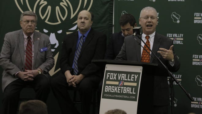 Oshkosh City Manager Mark Rohloff talks to the crowd that gathered Feb. 8 at the Oshkosh YMCA after the Milwaukee Bucks announced plans to bring a minor-league basketball team to Oshkosh.