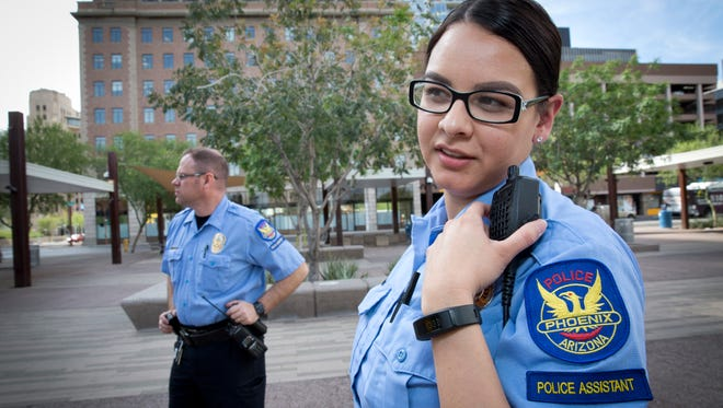 Vanessa Rivas and James Rising Eric have a combined 19 years of service as Phoenix police assistants. Police assistants are civilian workers, not sworn officers.