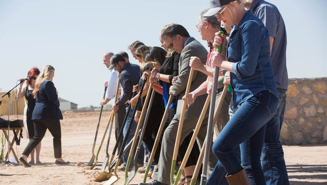 A group of city and county officials, and members of the Las Cruces Home  Builders Association, participate in a groundbreaking for the 2018 Anniversary House. Wednesday, April 4, 2018.