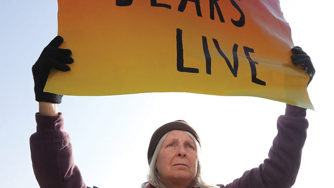 Jean Daniels expresses her opposition to the black bear hunt across the street from the Whittingham Wildlife Management Area. (Kevin R. Wexler/@krwphoto)