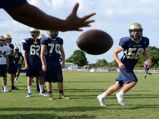 Holy Trinity's Jake Lang catches a lateral during practice Friday afternoon.