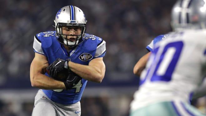 Zach Zenner of the Detroit Lions runs for a touchdown against the Dallas Cowboys on Dec. 26, 2016, in Arlington, Texas.