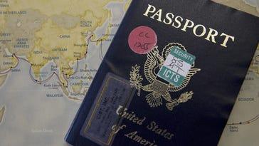 Jud Burkett / The Spectrum Pricilla Dickson's passport sits on top of a map showing the route of their round the world cruise Wednesday.