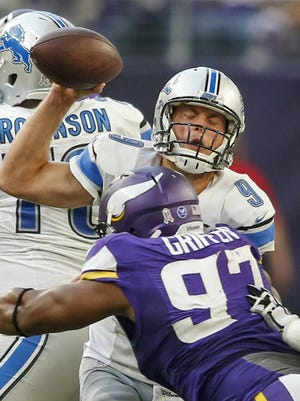 Matthew Stafford is pressured by Minnesota's Everson Griffin. Stafford was sacked only once and hit four times in Sunday's overtime victory.
