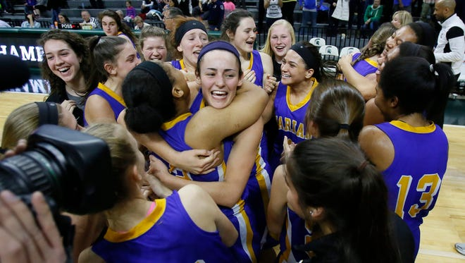 Bloomfield Hills Marian players celebate their 51-37 win over Dewitt in MHSAA Class A girls basketball final on Saturday, March 21, 2015 in East Lansing.