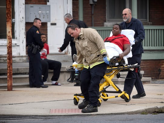 A gunshot victim is transported from the intersection of Second Street and Lehman Street Tuesday, Nov. 1. The shooting occurred at 302 E. Weidman St. The victim was taken by ambulance to a local hospital and did not appear to be seriously injured.