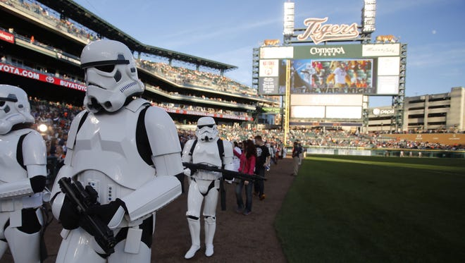 Star Wars characters march around Comerica Park during Star Wars night for the Detroit Tigers baseball game against the Kansas City Royals on Sept. 14, 2013.