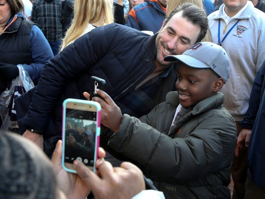 Tigers pitcher Justin Verlander takes a picture with Korry Buxton at TigerFest on Jan. 21, 2017 at Comerica Park in Detroit.