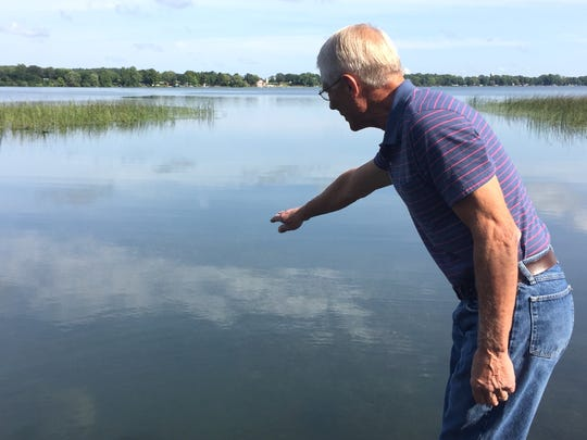 Grand Lake Area Association board member Jim Meinz shows Tuesday, Aug. 15, where he and other members discovered the invasive species starry stonewort in the lake on Aug. 11.