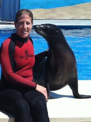 Jessica Peranteau and Dichali the sea lion at Six Flags Great Adventure.