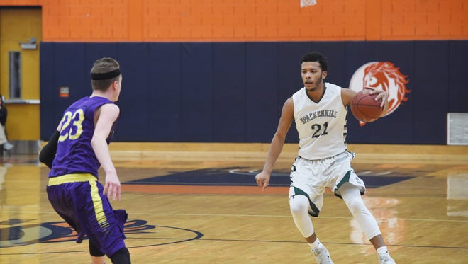 The Spackenkill High School boys basketball team, shown here in its Section 9 Class B title win over Rhinebeck, is in action in the state tournament this week.