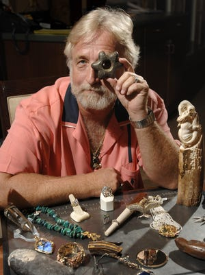 Pictured in July 2008, Rocky Hard, owner of Rock Hard Designs on Palafox Street, pictured with some of his most prized possessions, including an Inca Star - a stone tomahawk which he discovered in the highest part of the Andes Mountains with a 12-fingered guide. Hard has been collecting fossils, precious gemstones and artifacts since he was 10-years-old and started making jewelry and crafts in 1969.