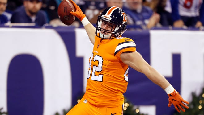 Denver Broncos tight end Jeff Heuerman (82) reacts to scoring a touchdown on a 54-yard pass play against the Indianapolis Colts during the 3rd quarter at Lucas Oil Stadium on Dec. 14, 2017, in Indianapolis, Ind.