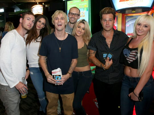 Singers Aaron Carter (third from left), Ryan Cabrera (second from right) and guests attend Dave & Buster's Hollywood & Highland Grand Opening on Aug. 21, 2014, in Hollywood, California.