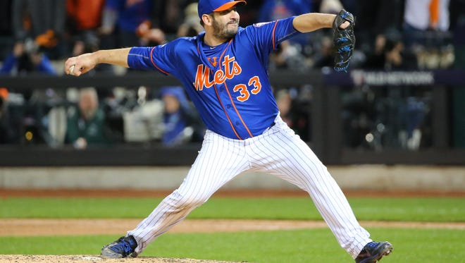 New York Mets pitcher Matt Harvey throws against the Chicago Cubs in the Game 1 of the NLCS at New York's Citi Field.