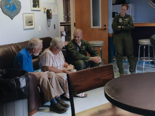 In this photo taken in August 2019, Paula Ferrel, second left, receives a bible that belonged to her father, World War II Pvt. Millard Weekley at the U.S. Airforce base in Coraopolis, Pa. Local Belgian policeman Serge Fafchamps and Lt. Col. Jim Moretti of the 171st Air Refueling Wing worked together with Marcel and Mathilde Schmetz at the Remember Museum 39-45 in Belgium to reunite the daughter with the bible more than 70 years later. Veterans of the WWII Battle of the Bulge are heading back to mark, perhaps the greatest battle in U.S. military history, when 75-years ago Hitler launched a desperate attack deep through the front lines in Belgium and Luxembourg to be thwarted by U.S. forces. (Serge Fafchamps via AP)