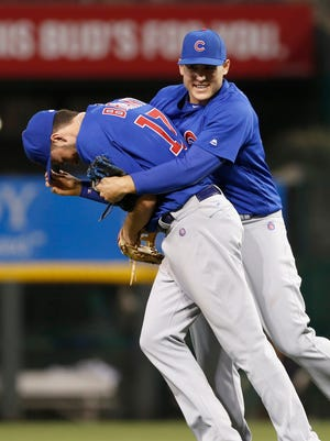 Cubs third baseman Kris Bryant and first baseman Anthony Rizzo celebrate after the Cubs defeated the Reds at Great American Ball Park.