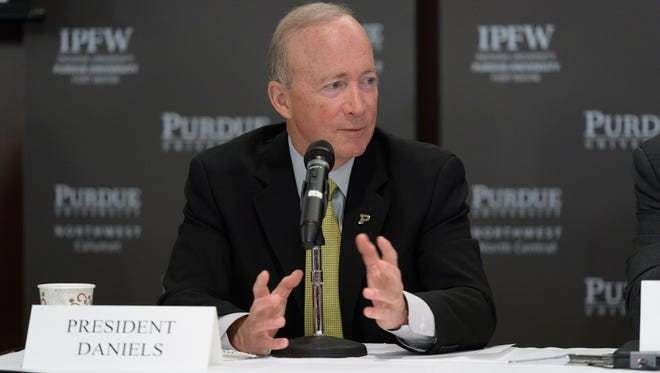 Purdue President Mitch Daniels on Thursday lays out plans to take on Kaplan University to expand Purdue's reach online to new students.