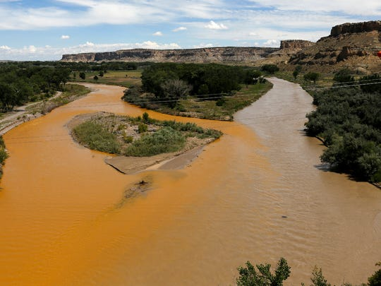 The confluence of the San Juan River is pictured Aug. 8 in Farmington after the Gold King Mine spill. At left is the contaminated Animas River, and at right is the San Juan River.
