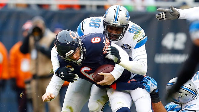 Chicago Bears quarterback Jay Cutler (6) is sacked by Detroit Lions defensive end Devin Taylor (98) during an NFL football game, Sunday, Jan. 3, 2016, in Chicago.
