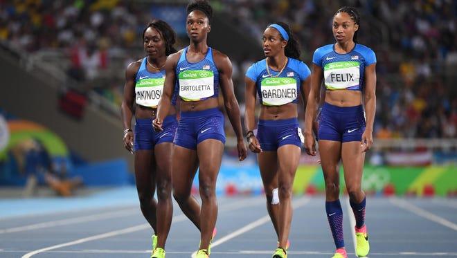 Tianna Bartoletta , Allyson Felix , English Gardner and Morolake Akinosun (USA) after the women's 4x100m relay heats in the Rio 2016 Summer Olympic Games at Estadio Olimpico Joao Havelange.