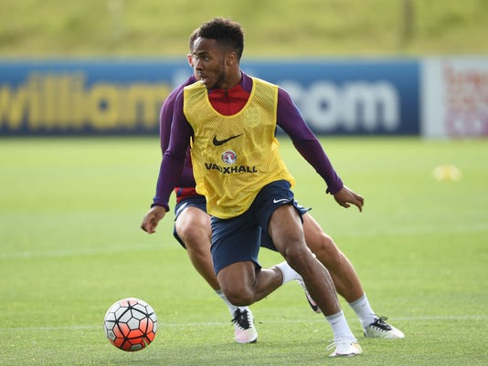 England's Raheem Sterling runs with the ball during their training session at St George's Park, Burton, England, Wednesday, May 18, 2016. England will play an international soccer friendly against Turkey on Sunday, May 22. (Joe Giddens/PA via AP)      UNITED KINGDOM OUT       -    NO SALES     -    NO ARCHIVES