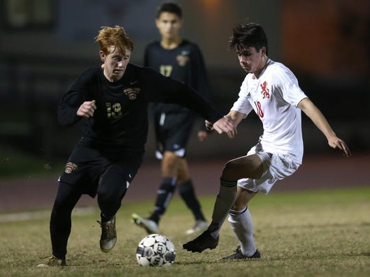 Florida High's Chase Allbaugh dribbles past Leon's Tommy Jusko during their match at Leon High School on Wednesday, Jan. 4, 2017.