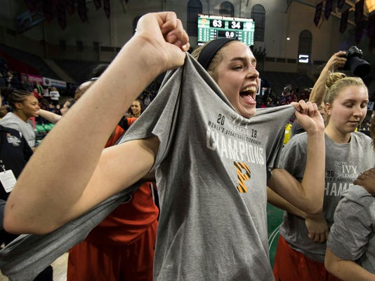 Princeton's Bella Alarie reacts with her new T-shirt as she celebrates after an NCAA college basketball championship game against Pennsylvania in the Ivy League Tournament, Sunday, March 11, 2018, in Philadelphia. (AP Photo/Chris Szagola)