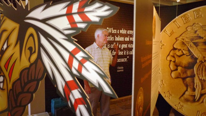 "Michael Hammond , Executive Director of the Agua Caliente Cultural Museum, explains the purpose of the exhibit, ""Where are the Tipis?"" in this 2012 file photo at the cultural museum.  Hammond has anounced his retirement from the museum."