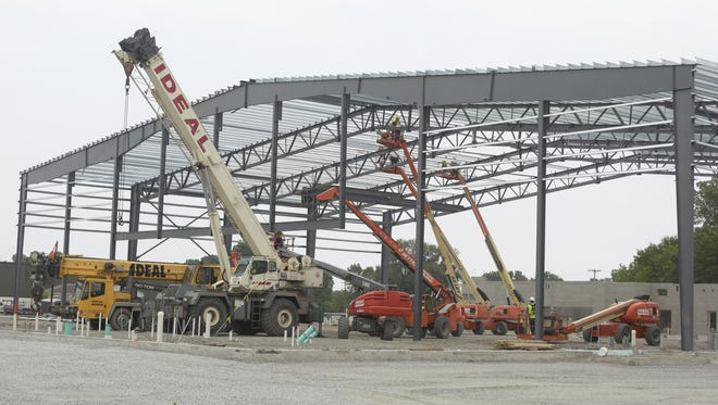 Crews from Bayland Building Inc. continue construction Monday, June 12, 2017, on the Oshkosh Arena, which will house Fox Valley Pro Basketball and the newly named Milwaukee Bucks D-League team, the Wisconsin Herd.