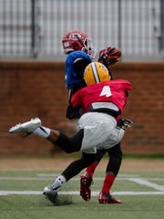 Lee's Henry Ruggs III catches a pass as Jeff Davis' Zyon Gilbert defends during practice on Tuesday, Dec. 6, 2016, at Huntingdon College in Montgomery, Ala., for the Alabama vs. Mississippi All Star Game.