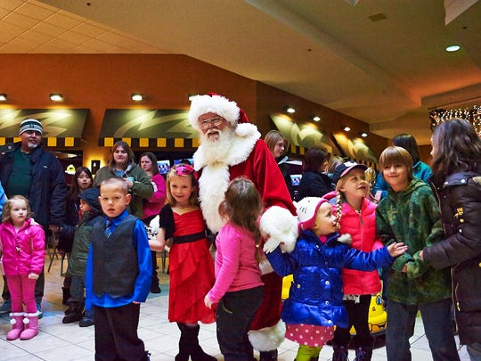 Santa Claus greets children at Lakeview Square Mall on Saturday.
