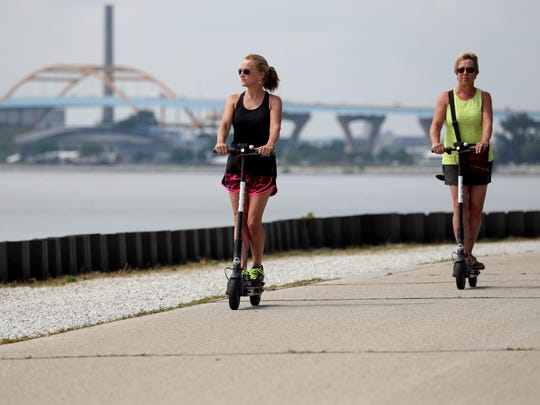 Carolyn Gambill (left) of Milwaukee and her sister, Jeannie Cleveland, visiting from Boulder, Colorado, ride Bird scooters along  the lakefront near Veterans Park in Milwaukee on Monday.