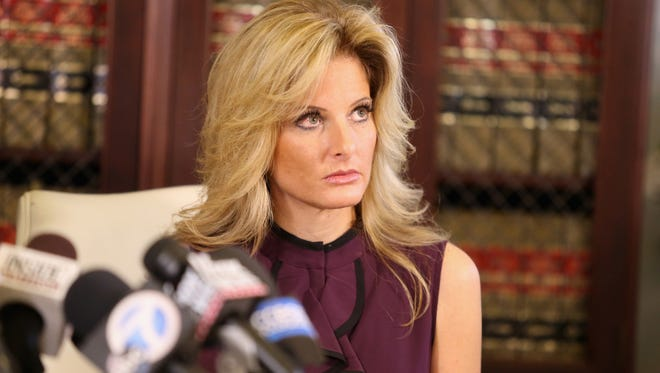 """Summer Zervos, a former candidate on """"The Apprentice,"""" speaks to the press with her attorney Gloria Allred Oct. 14, 2016 in Los Angeles."""