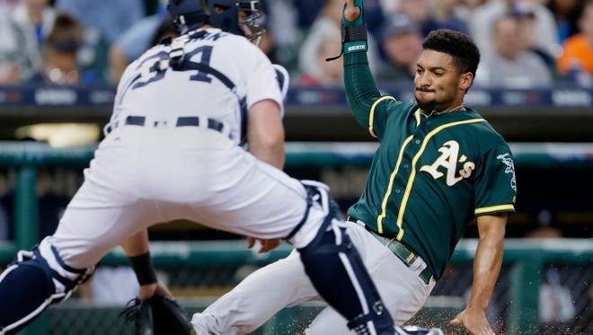 Athletics shortstop Marcus Semien scores against Tigers catcher James McCann from first base on a double by Jed Lowrie during the first inning on Monday, Sept. 18, 2017, at Comerica Park.