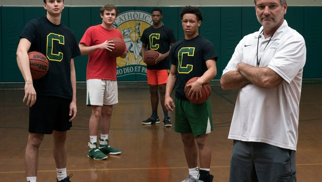 Catholic High School senior starters, L to R: Luke Stringfellow, Alec Grimes, Kyheem Coleman and Demarius Nickerson, with help from coach Jeff Gill, are looking to take the Crusaders to the next level with a win in the upcoming playoff game.