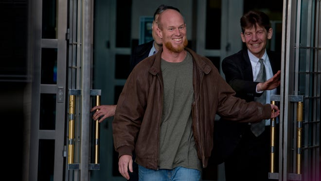 Eric McDavid, 37, walks out of the Federal Courthouse in Sacramento with his attorney's Ben Rosenthal and Mark R. Vermeulen, right, after being released from prison, Thursday.