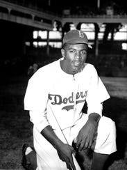 Jackie Robinson of the Brooklyn Dodgers poses at Ebbets Field on April 11, 1947, his first year in the Major Leagues.